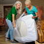 women putting mattress bag on mattress